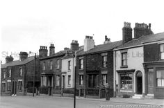 Black and white photograph showing terraced housing in Prescot Road, St.Helens 1960