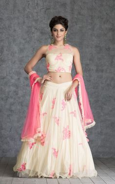 Look smart and sexy in this featherlite almond paste tulle lehenga embroidered with floral aari motifs in hot pink color and a sleeveless tulle embroidered choli. The matching embroidered hot pink tulle dupatta completes the look.
