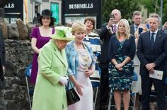 Secretary of state for Northern Ireland Theresa Villiers and First Minister Arlene Foster watch the arrival of Queen Elizabeth II and Prince Philip attend the unveiling of the Robert Quigg VC memorial statue in Bushmills village in Bushmills, Northern IrelandCarrie Davenport/Getty