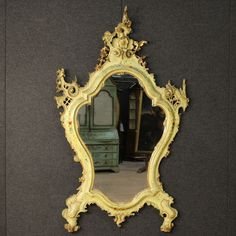 Price: 2800€ Big Venetian mirror of the second half of the 19th century. Furniture finely carved, gilded, lacquered and hand painted with floral motifs. Rare mirror even for the special asymmetrical construction: note the sculpture of a castle at the top right. It presents some paint drops, on the whole in good state of conservation (mirror in excellent condition). #antiques #parino Visit our website www.parino.it