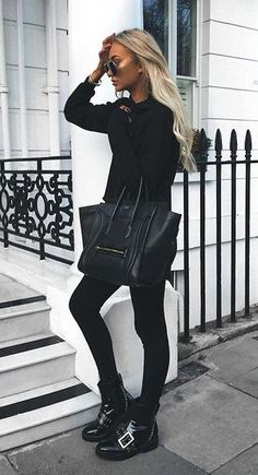 all black. buckle ankle boots.