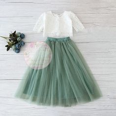 This stunning party outfit features a beautiful white lace crop top with faux pearl button back and mid-length tulle skirt in a gorgeous ice blue hue. This dress is so perfect for dressing up, parties, easter sunday outfits, family photos and more! Green Tulle Skirt, Green Flower Girl Dresses, Green Bridesmaid Dresses, Tulle Dress, Green Dress, Tulle Skirt Kids, Tutu Skirts, Tulle Tutu, White Lace Crop Top