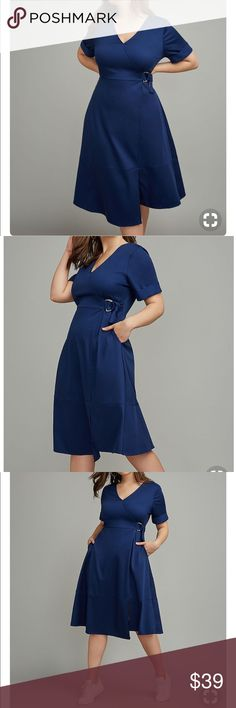 Lane Bryant faux surplice dress by Glamour X Navy Blue faux wrap dress. Short sleeve with gold up edges. Dress fits like a fit n flare dress. This dress is sold out and for good reason. This piece is stunning and flattering and amazingly comfortable to wear!!  New with tags. Lane Bryant Dresses