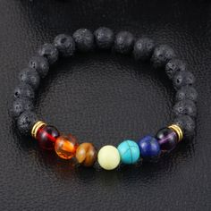 Lava Rock 7 Chakra Reiki Prayer Healing Bracelet. Jewelry by Peace of Mindfulness. Chakras are used for balancing energy, cleansing and restoring energy through meditation practice. Plus, they look ultra stylish and make great fashion accessories for any outfit.