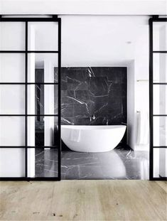 Bathroom by Space Copenhagen. Black marble bathroom floor and bath backdrop. Bad Inspiration, Bathroom Inspiration, Bathroom Ideas, Bathroom Goals, Bathroom Inspo, Bathroom Interior, Modern Bathroom, Minimalist Bathroom, Master Bathroom