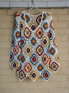 This cute crochet blouse handmade crocheted in vintage granny square pattern wit. This cute crochet blouse handmade crocheted in vintage granny square pattern wit. Knitting Pullover, Cardigan Au Crochet, Crochet Jacket Pattern, Gilet Crochet, Granny Square Crochet Pattern, Crochet Squares, Crochet Cardigan, Crochet Shawl, Knit Shrug