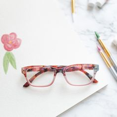 Bring new meaning to putting a flower behind your ear in these retro square readers that offer a colorful, faded floral print and spring hinges. Glasses Trends, Spring Hinge, Autumn Activities, What's Trending, Reading Glasses, Stuff To Do, Floral Prints, Ear, Flowers