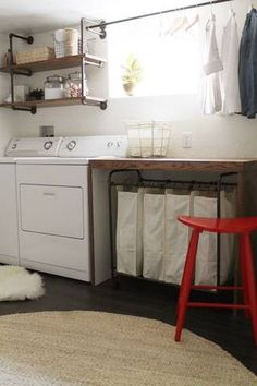 Perfect Basement Idea.. love the rack for drying clothes- out of the way