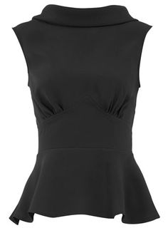 Black peplum top. I flatter myself but I do look very lovely in these high boat neck tops.