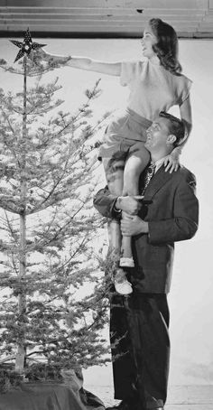 Candra, just like the pic I took this year of you, the two of you should do this pic every year for your Christmas Cards! in Black and White of course. Janet Leigh & Robert Mitchum