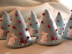 forest of tree ornaments made by cathy gaubert, via Flickr. So adorable with bunnies and mushrooms!  Made using pattern from:  http://littlebirds.typepad.com/little_birds_handmade/2006/11/soft_tree_patte.html