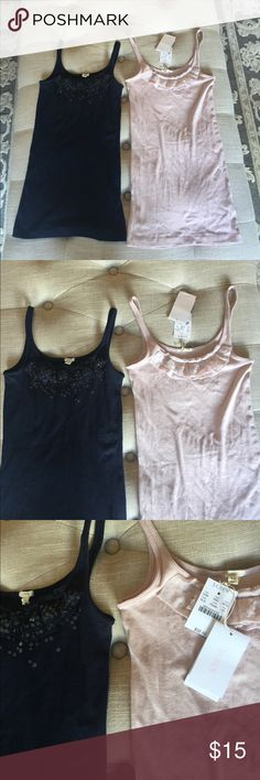 Tank tops. One pale mauve/pink J. Crew tank top and one dark blue tank top. They are very soft and stretchy. The fronts have a little silk ruffle, with a little sequence sprinkled throughout. J. Crew Tops Tank Tops