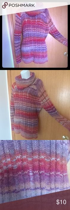 VIP colorful striped turtleneck sweater This is a classy stripped turtleneck sweater. The colors remind me of a sunset; reds oranges purples and pink. Material tag shown in the last picture. Its delicate so please handle with care! Never worn just been sitting in my closet for a while just never got aroujd to wearing. Its super thick and warm! Size large VIP Sweaters Cowl & Turtlenecks