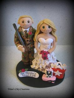 Wedding Cake Topper, Custom made Bride with Shopping Bags, Groom in Camo Tux with Gun by trinasclaycreations