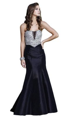 Glow with the elegance of a regal beauty in this fascinating Nox Anabel 8243 creation. This dazzling long dress parades in a strapless sweetheart neckline with sheer fabric and full sequined fitted bodice. The back reveals mid-open and zipper closure while the skirt elegantly flares for the mermaid effect. Glam up for a night with a sophisticated flair in this Nox Anabel masterpiece.