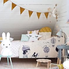 Mustard hints for a kiddies room and such a cute room too.