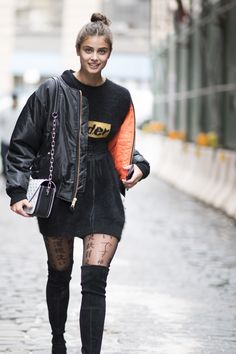 Taylor Hill in a Black Bomber Jacket.