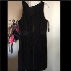 Black lace dress The front has a zipper helps adjust to your body really fancy . Dresses