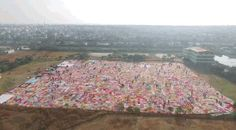Over 2,000 women from around India and 13 other countries gathered in Chennai and wove a blanket with the staggering area of 11,148.5 square meters. | Over 2,000 Women Got Together In India To Make The World's Largest Crochet Blanket