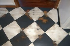 painted wood floor for client with floor issues- wood shows through finish but blends with neighboring wood floor.