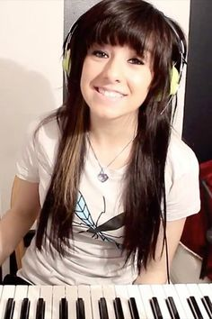 So young here too. Image credit: http://stealherstyle.net/wp-content/uploads/2012/01/christina-grimmie-mosquito-t-shirt.jpg