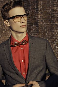 Men's glasses  frames.  Well coordinated look. Grey jacket red shirt and plaid bow tie #style