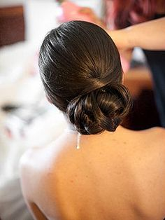 Low chignon/bun - OMG love this one, with the weaved pieces but still slick and smooth