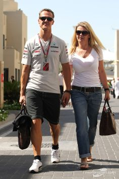 Michael Schumacher, Mercedes GP and his wife Corina. Photo by XPB Images on November 2011 at Abu Dhabi GP. Michael Schumacher, Mercedes Gp, Automobile, Ferrari F1, F1 Drivers, Famous Couples, F1 Racing, Car And Driver, F 1