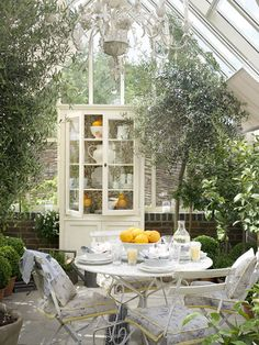 Inside a romantic glassed conservatory… this would be a dreamy spot for breakfast