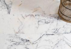 An economy grade of polished marble, with striking violet veining and amber quartz detail throughout.
