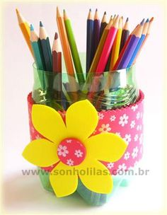 Up cycling bottles into pencil holders