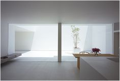 Takuro Yamamoto Architects - white cave house living room and terrace courtyard