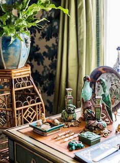 "Inside the stunning home of the Ultimate A-list decorator: Alex Papachristidis. A vignette on Alex's desk combines two of his passions: animal motifs and chinoiserie. He's also a big proponent of indoor plants. ""It's important to have living things in the house other than the people. Photo by Lesley Unruh. One Kings Lane Designer Houses."