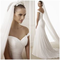LOVE the top and way it flows into midsection. Couldn't imagine it'd be great for a beach wedding though