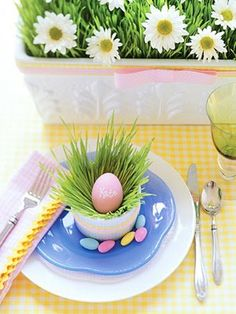 Easter table setting:  Write names on eggs, dye, and place in little cups filled with wheat grass.  Surround with Jordan almonds.  So cute!!