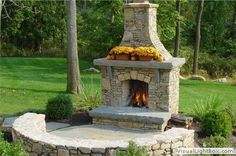 Image from http://www.landscapeaesthetics.com/data/images/outdoorstonefireplacewithseatwall.jpg.