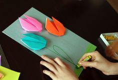 We made a little art project with some super-simple origami tulips. With only a few folds, this is a great origami project for anyone! Spring Drawing, Spring Art, Spring Crafts, Fun Crafts, Crafts For Kids, Arts And Crafts, Paper Crafts, Craft Activities For Kids, Stem Activities