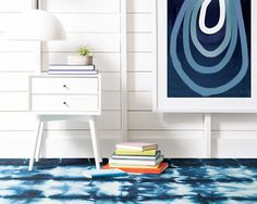 Inspired by the indigo dye pits of Kano, Nigeria, this micro-hooked wool area rug is hand folded and dyed, resulting in a truly unique design on each rug. The high-contrast blue-on-white designs add instant personality to both bright and neutral spaces, while the durable weave makes this wool rug ideal for high-traffic areas.