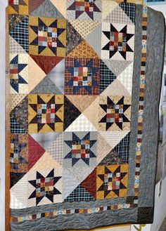 """Twilight Stars by Cheryl Wall...  Each finished block is 8"""" by 8"""", the finished quilt is 70 1/"""" square.   We have Twilight Stars on display over the swinging door leading to the kitchen at the shop :)"""