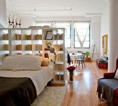 brooklyn loft transformation.: i've always loved the idea of using a bookshelf as a room divider.