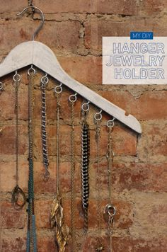 21 Useful DIY Jewelry Holders- Cuphooks screwed into a wooden hanger make a simple way to organize necklaces.