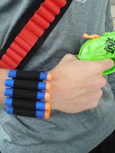 Nerf Gun Dart Holder Wrist band Rambo Bandolier. Completely customize-able to your size and fabric colors! If you need expedited processing, shipping, combined shipping, or Mega sized dart holders just message me.  Comes in a standard Adjustable Size to fit from 6-7.5 wrist in a Black band with black loops  Listing is for wrist-band only. Darts are not included.  Add a note to seller at check-out or message me to request a custom order!  Ready to ship USPS- (calculated shipping)