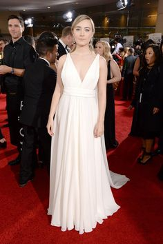 Golden Globes 2016 Red Carpet Award Show Dresses Saoirse Ronan The Brooklyn nominee channeled a modern Grecian goddess in Saint Laurent Couture by Hedi Slimane with classic white diamond Chopard drops. Golden Globes 2016, Golden Globe Award, Award Show Dresses, Grecian Goddess, Hedi Slimane, Nice Dresses, Formal Dresses, Chopard, Red Carpet Fashion