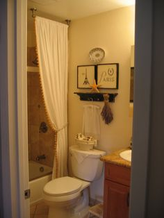 Shower curtain & sliding glass door - didn't think it could work but I like this look!