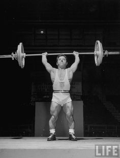 American bantamweight Joseph DePietro competing in weightlifting event at the Summer Olympics where he took the gold, 1948. photo by Mark Kauffman