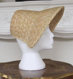 "This lovely style is also called a ""Spoon Bonnet"". Made exclusively for us, this natural straw bonnet easily combines with your early Victorian and civil war wardrobe. Trim your bonnet with feathers and ribbons to make it a unique treasure! War Bonnet, Bonnet Hat, Vintage Princess, Costume Hats, Historical Costume, Doll Clothes Patterns, Hat Making, Fashion History, Beautiful Dolls"