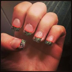 My Niece Lexi's Camo Nails.  She had white tips put on then she added decals she got from the internet...CUTE!