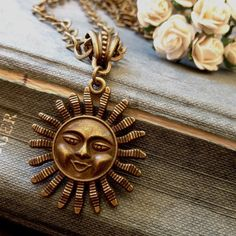 Here comes the sun.  Bronze sun necklace.  Symbol of energy. From a selection of Bohemian jewelry now in the  IVINTAGE sale. Free delivery.  Eco-friendly packaging.  Sustainable materials. Discount code ILV10OFF at checkout for all you happy hippies  www.ilovevintage.co  #bohostyle #bohemian#1970s #sun#summer#energyhealing #bohemianjewelry #bohobride #hippiebride #hippiegirl#hippie #hippiechick #picoftheday #photooftheday #1970sfashion #ecofriendly #vegan#vegetarian #vegi#flowerchild…