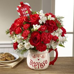 The FTD® Believe™ Mug Bouquet by Hallmark Mercy's Flowers 5500 W Flagler St Coral Gables, FL (305) 264-5053 mercysflowersonline.com provides flower and gift delivery to the entire Miami, FL area wth a large variety. #christmas #bestflorist #bestflowerarrangement #December #gift #miamiflorist #miamiflowers #floristinmiami #miamiwinter #getwell #missyou #sayitwithflowers #lastminutegift