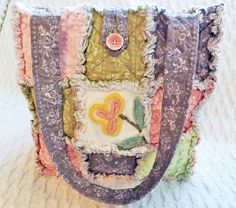 Rag Quilt Tote made with Vintage Chenille, Pink, Green, Gray, Soft Pastel, Handmade    This rag quilt tote is made with beautiful vintage chenille squares and soft pastel quilt fabric in lovely florals. The chenille is cut from vintage bedspreads, the chenille flower is a rare one and there is a thin silver thread running through the upper pink square on the front. So pretty! Great bag to carry everyday or to use as a craft tote! Ready to ship! One large and three smaller pockets are sewn…